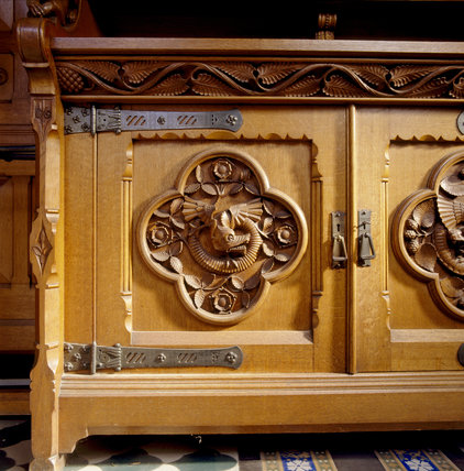 Close view of carved wooden cupboard door with large hasps