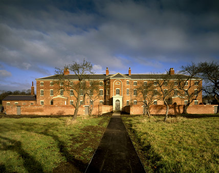 IMAGE OUT OF DATE - EXTENSIVE GARDEN WORK HAS CHANGED THE APPEARANCE. View of the front facade of this Nottinghamshire workhouse taken in the morning light. Built in 1824 by the Rev.John Becher, it is now Grade 11* liste