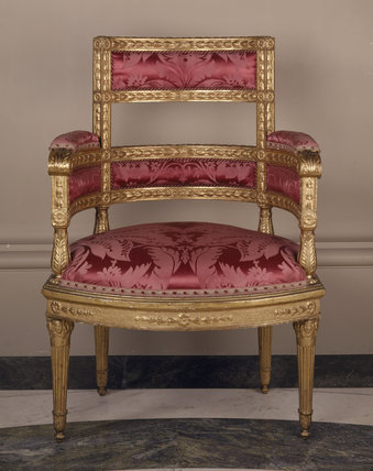 Carved armchair, late 18th century, giltwood and gesso, from the Drawing Room at Ickworth
