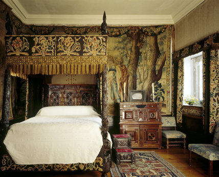 View of King Charles Room showing bed and tapestries