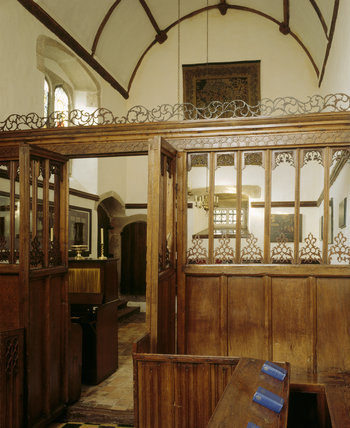 View from altar towards nave showing the barrel-vaulted roof with wooden ribs bearing the Tudor rose at intersections