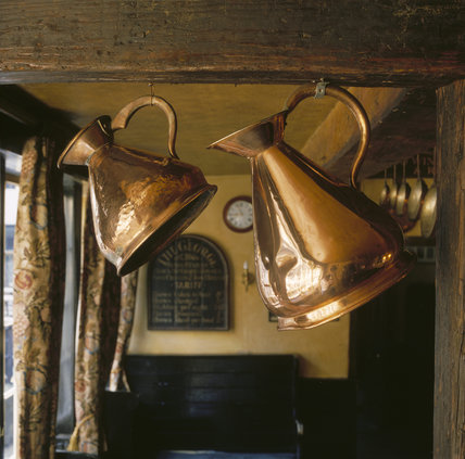 Copper pots hanging in the George Inn, Southwark, the only remaining galleried inn in London