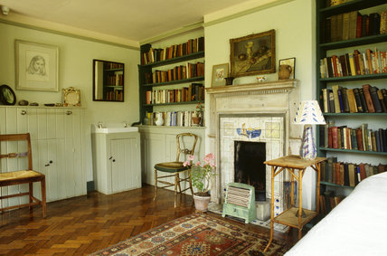 The interior of Virginia Woolf's bedroom at Monks House looking towards the fireplace