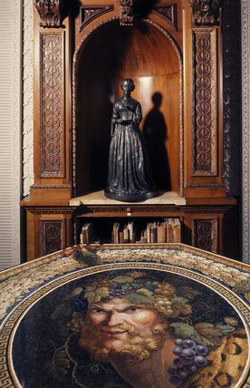 Library statuette of Florence Nightingale at Claydon House, with the octagonal terrazzo table of a Bacchus head by G Cuilt 1825