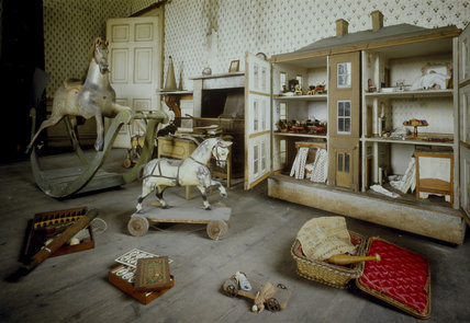 The Schoolroom at Calke Abbey with many toys including a rocking horse, a dolls house and other games