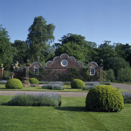 A view of the Gabled North Pavilion at Erddig looking across the topiary's on the lawn