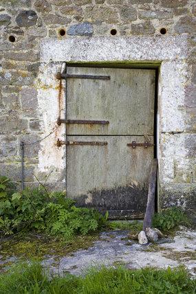 Door On Old Farm Building At Godolphin House, Near Helston, Cornwall