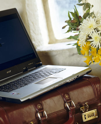 Close view of conference or working facilities - a laptop resting on a case