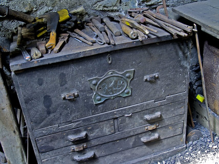 A close view of an old chest at Finch Foundry with tools