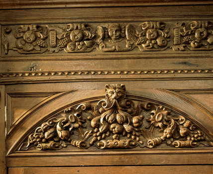 Barrington Court - Detail of carved wooden frieze above the door in the Corridor at Barrington Court