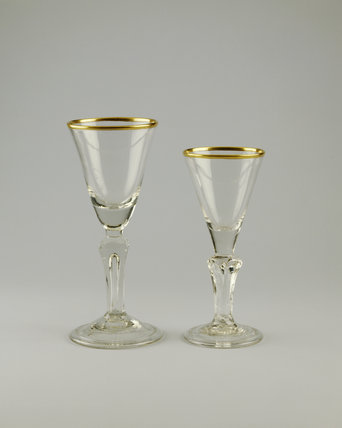 Shugborough Hall, two english funnel shaped glasses with gilt rims c.1740
