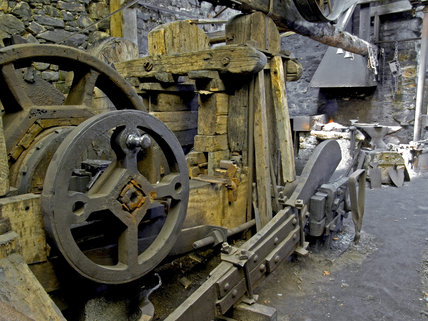 Inside Finch Foundry where hand tools were produced in the C19th and C20th, showing the anvil, drop hammer and tools