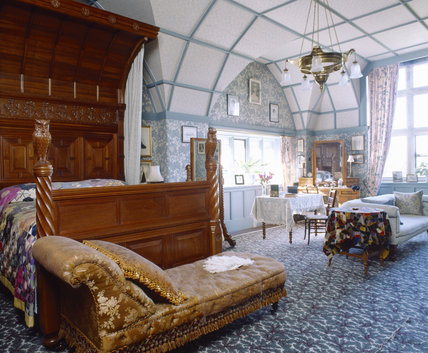 The Owl Suite with the bed designed by Norman Shaw in American Black walnut, at Cragside, Northumberland