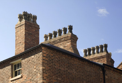 Close view of the chimney stacks of the Birmingham Back to Backs, revealing how many separate chimneys there were, and how many households lived at Court 15