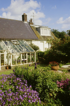 View across the garden at Monk's House looking towards the South facing conservatory added in the 1940s by Leonard and Virginia Woolf