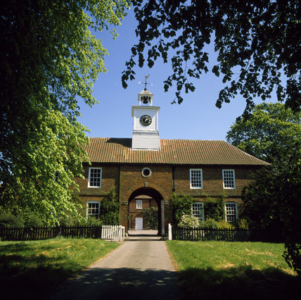 Gunby Hall stableyard with its arched entrance and Georgian clock tower built by William Meux Massingberd (grandson of the builder of the house) in 1735