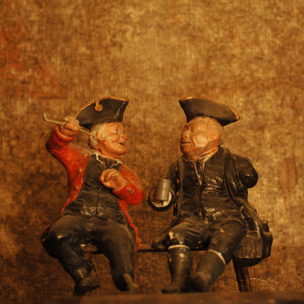 Plaster sculpture of two old sailors, part of the Charles Wade collection, in the Grey Room at Snowshill Manor