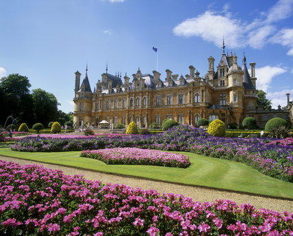 Exterior view of Waddesdon Manor with colourful summer bedding