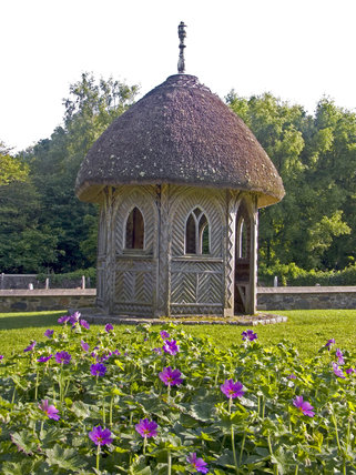 The thatched gazebo in the garden at Finch Foundry