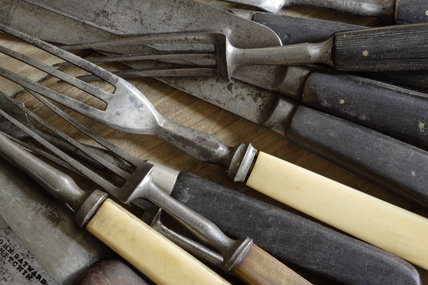 A collection of cutlery in the 1870s house at Birmingham Back to Backs