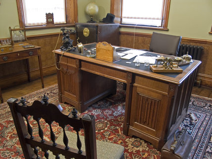 The Manager's Office at Quarry Bank Mill, Styal showing the desk, safe  and chairs