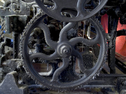 Close-up of a cog wheel on one of the machines in the weaving shed at Quarry Bank Mill, Styal