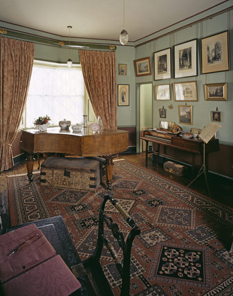 The Music Room at A la Ronde with a walnut boudoir grand piano, made by the Knake brothers of Munster in the mid-nineteenth century