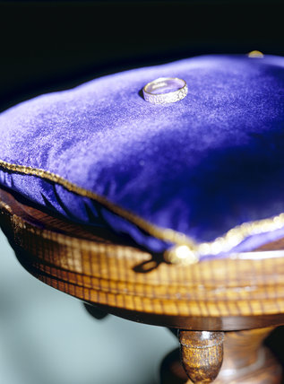 Close shot of a weding ring resting on a velvet cushion, to illustrate the range of wedding facilities available at National Trust properties