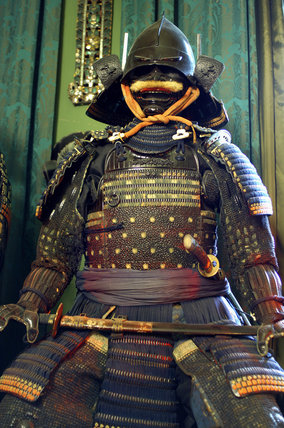 Close view of part of the remarkable collection of Japanese Samurai armour from the C17th to C19th, in the Green Room at Snowshill Manor