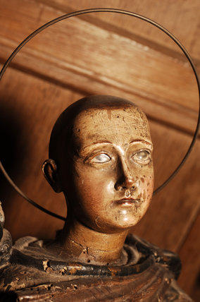 A carved wooden figure of a Saint, in the room called Nadir, at Snowshill manor, home of the collector Charles Wade in Gloucestershire