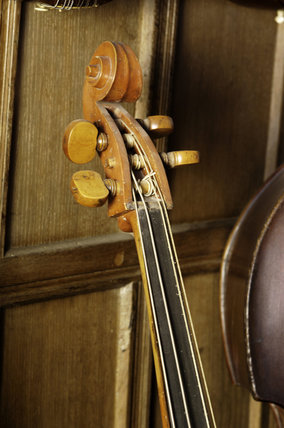Head of a double bass, 1809-1892, part of the musical instrument collection of Charles Paget Wade in the Music Room at Snowshill Manor, Gloucestershire