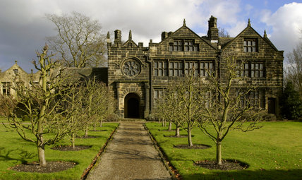 Exterior view of the garden front of East Riddlesden Hall at Keighley, West Yorkshire, a seventeenth-century manor house with an unusual rose window above the porch