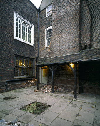 View North West across the courtyard at Sutton House towards the C16th Armada window in its 1700 location The porch was added in 1904