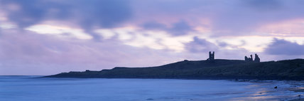 Evening view across Embleton bay to Dunstanburgh castle