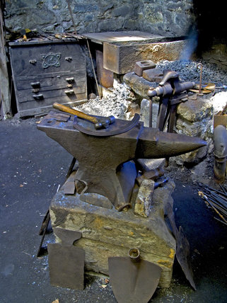 The anvil in the forge at Finch Foundry, Devon where agricultural and mining hand tools were produced in the C19th