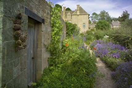 The garden and house of Snowshill Manor, Gloucestershire, UK