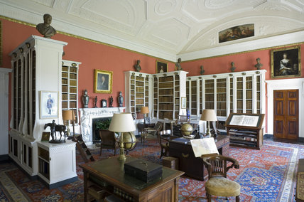 The Library at Belton House, Lincolnshire, UK, showing the marble chimney-piece with caryatid supports representing Ceres and Pomona