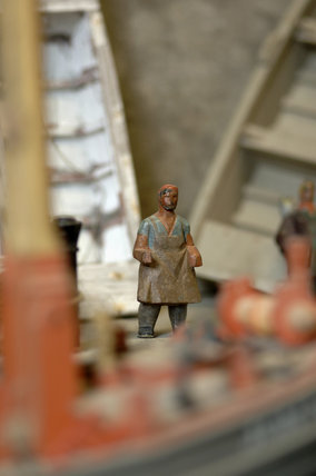 Close view of a wooden figure, part of the reconstruction of Wolf's Cove, the model village which was once in the garden at Snowshill Manor but is now in the room known as Occidens