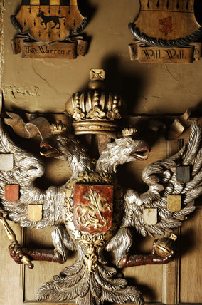 Carved wooden Russian imperial coat of arms on the wall of Dragon at Snowshill Manor, Gloucestershire
