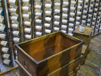 View of a warping frame containing bobbins at Quarry Bank Mill, Styal