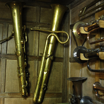 Bass ophicleides, c.1830, part of the musical instrument collection of Charles Paget Wade in the Music Room at Snowshill Manor, Gloucestershire.