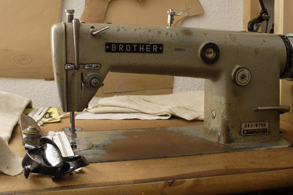 A Brother sewing machine, part of the tools of the trade in the upper rooms of the 1970s tailor's shop in the Birmingham Back to Backs
