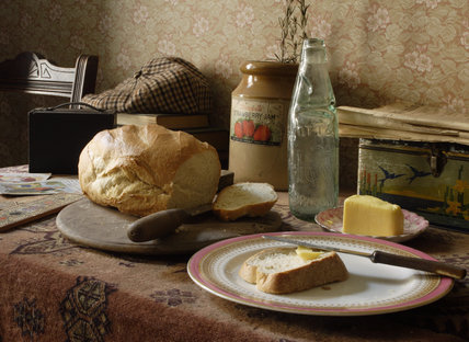 Bread and butter, and a loaf, on a side table in the parlour of the 1930s house in the Birmingham Back to Backs