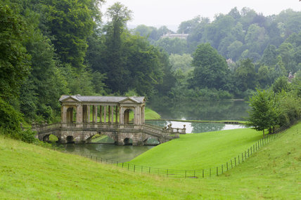 A view looking towards the Palladian Bridge at Prior Park, Bath, UK, a  large landscape park designed for Ralph Allen, with advice from Capability Brown, and Alexander Pope