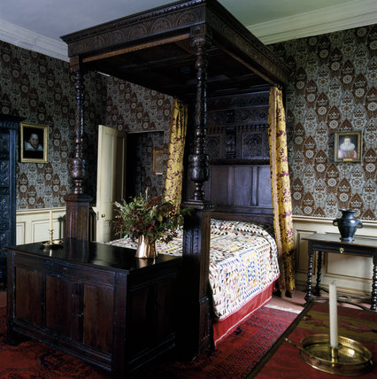 The grand four-poster bed in the King Charles Room