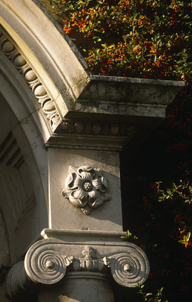 A detail of the portico of the main entrance to Polesden Lacey, it shows a beautiful carved stone rose