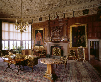 View of the Oak Drawing Room at Powis Castle, showing the fireplace, plasterwork ceiling, English mahogony seat furniture with gilt enrichments c. 1760