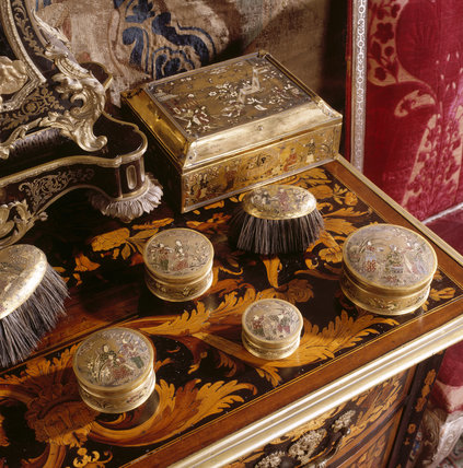 Close up of marquetry chest with enamel toiletry set in the State Bedroom at Powis Castle
