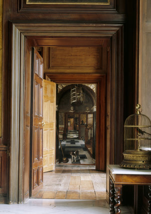A view down a corridor at Dyrham Park with the painting A VIEW DOWN A CORRIDOR by Samuel van Hoogstraeten in the background