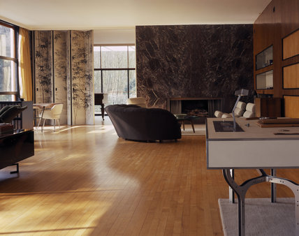 The Living Room at The Homewood designed by Patrick Gwynne has a maple sprung floor, the end wall is of polished black Levanto marble with veining and a fireplace cut neatly into it
